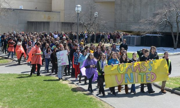 Hundreds of students march Wednesday on the University of Massachusetts campus in Amherst in support of UMass basketball player Derrick Gordon who recently announced that he is gay. At the same time, on the edge of campus, the anti-gay Westboro Baptist Church, stood for 45 minutes, protected by police to register their opposition to gay and lesbian causes. April 16, 2014.