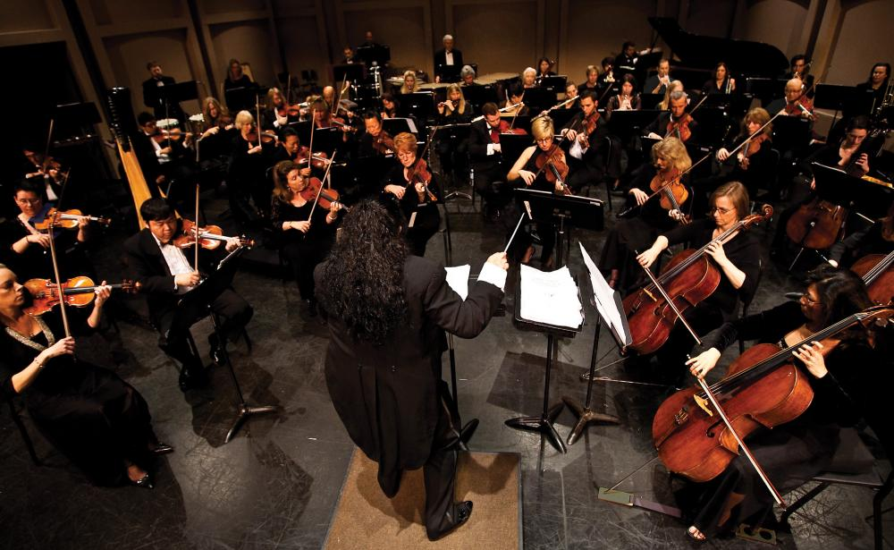 The 85 musicians in the Santa Cecilia Orchestra are paid professionals who play with other symphonies and in Hollywood studios.