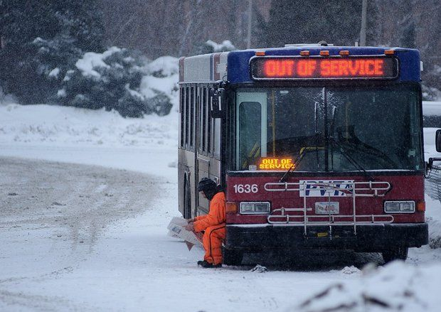 In February 2014, a PVTA worker takes a break in Holyoke, Mass., as heavy snow moves into the region.