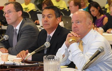 Massachusetts Gaming Commission chairman Stephen Crosby, right, appears with other members of the commission at Western New England University in Springfield in August 2012.