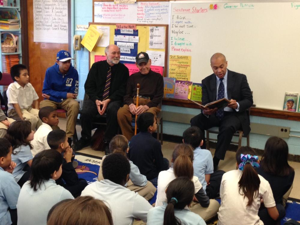 "Governor Deval Patrick reads ""A Home Run For Bunny"" to 3rd grade class at William DeBerry Elementary School in Springfield on Tuesday, Feb. 11, 2014. Sitting next to Patrick are Tony King (center) one of the book's subjects, and Richard Andersen, the book's author"
