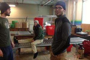 Fire Cider-makers Brian Huebner (left to right), Amy Huebner and Dana St. Pierre in their Pittsfield warehouse.