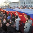 Demonstrators carry a Russian flag during a rally this week in the western Crimean city of Yevpatoria.