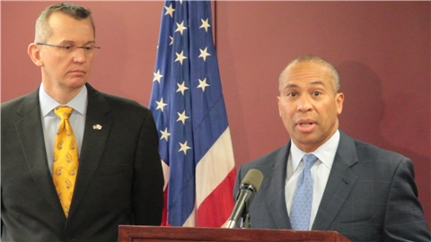 Health and Human Services Secretary John Polanowicz stood with Gov. Deval Patrick at a press conference announcing the resignation of Department of Children and Families Commissioner Olga Roche, on April 29, 2014.