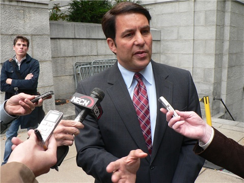 Richard Tisei speaks to reporters outside the State House in October of 2010.