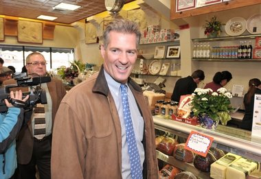 Then a U.S. senator from Massachusetts, Scott Brown gets ready to order lunch at Milano Importing Inc.  in Springfield, in January 2012.