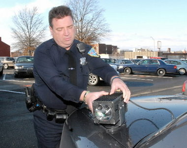 Springfield Police Officer David A. Standen adjusts a license plate reading device which is mounted on a police vehicle in this 2009 photograph.