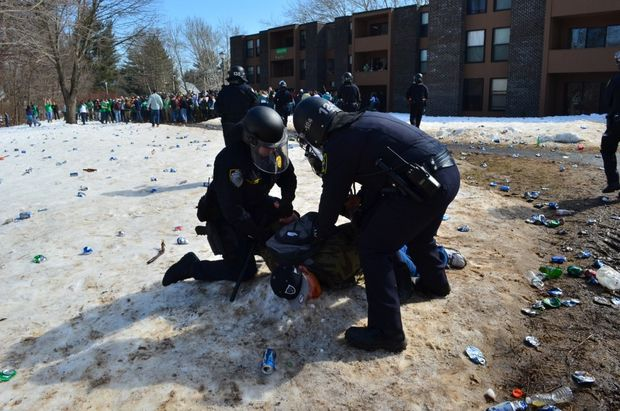 Police officers from Amherst, UMass and the Massachusetts State Police donned in full riot gear moved in on a crowd of what appeared to be several thousand people celebrating in the area of several large apartment complexes in North Amherst shortly after noon on Saturday, March 8, 2014.