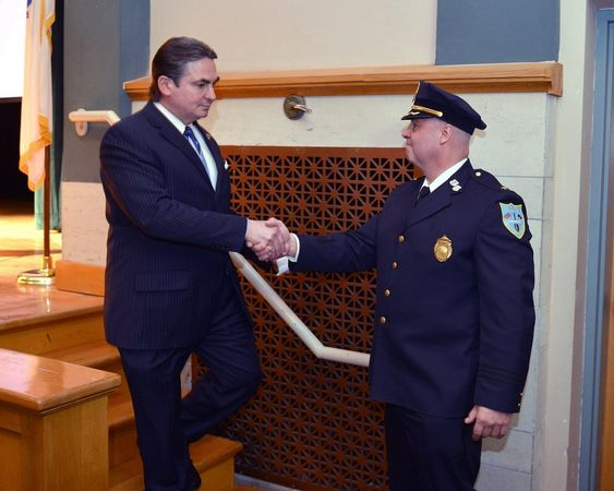Incoming Springfield Police Commissioner John Barbieri was introduced by Mayor Domenic Sarno during a presentation at Van Sickle Middle School, in April 2014.