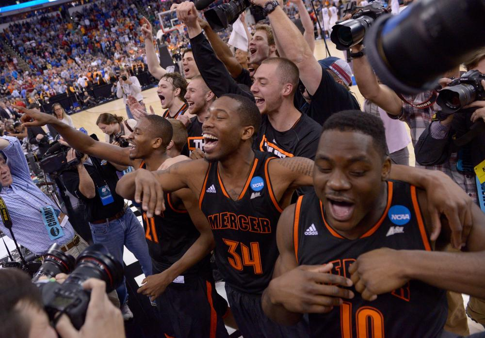 The Mercer Bears celebrate with after defeating the Duke Blue Devils 78-71 in the second round of the 2014 NCAA Men's Basketball Tournament.