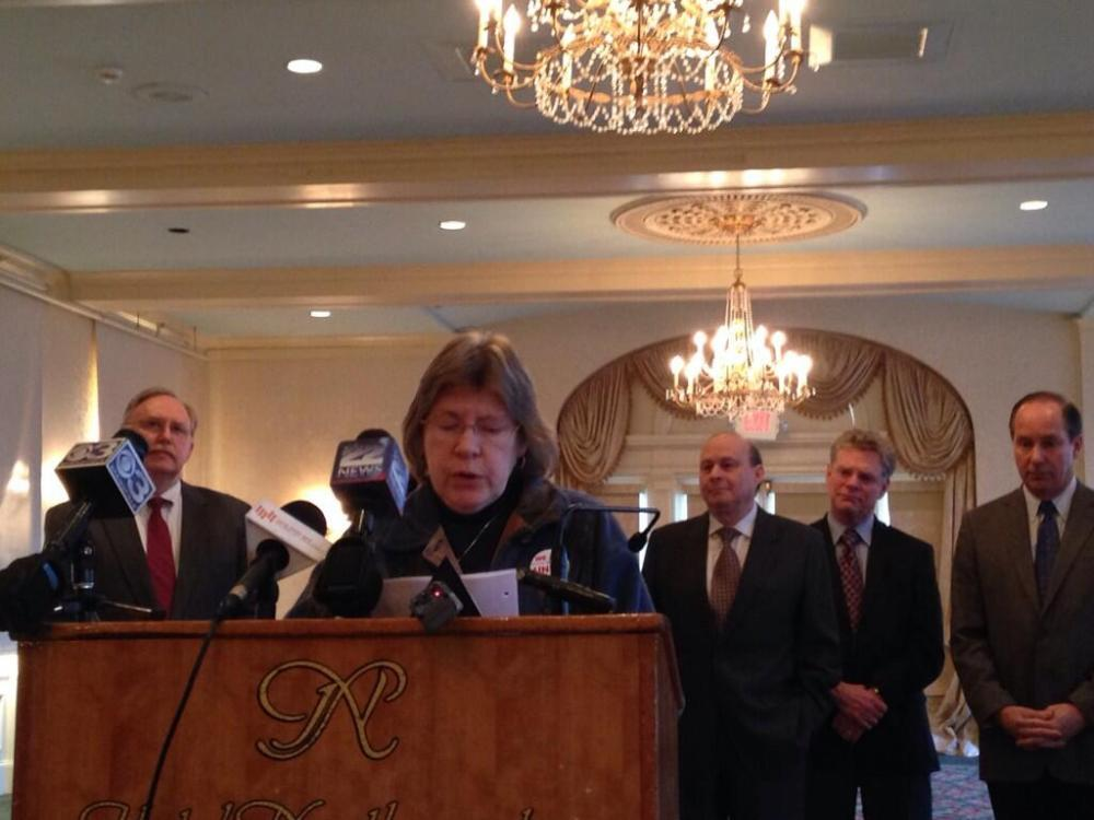 Linda Judd, co-chair of the Baystate Franklin union nurses' bargaining unit, speaks at a press conference.
