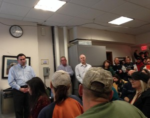 Kinder Morgan representatives listen to residents in a meeting over a proposed natural gas pipeline in Montague, Mass.