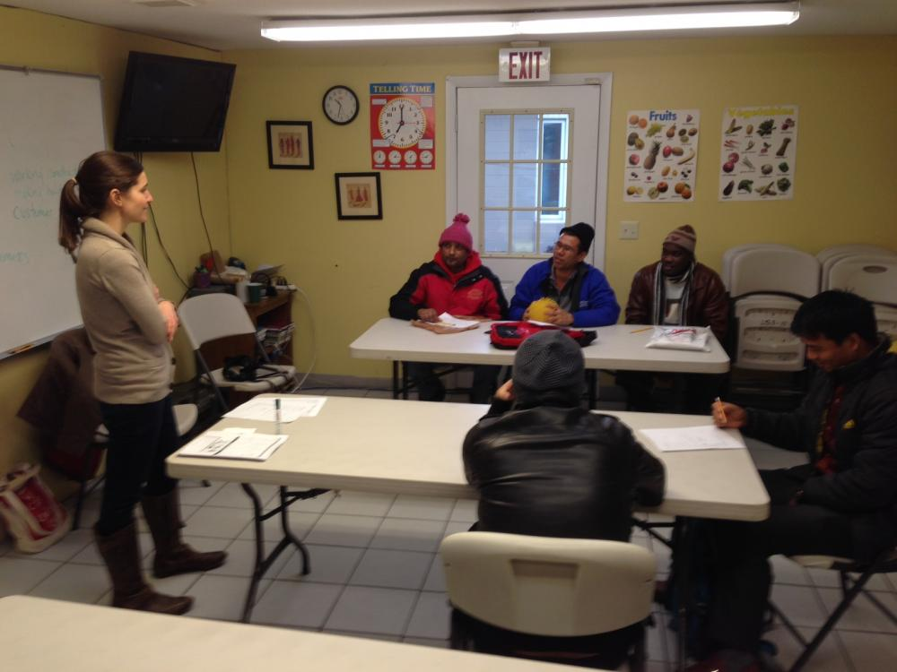 Lutheran Social Services teacher Erika Mendelsohn instructs a group of refugees from Bhutan, Sudan, Nepal, and Iraq.