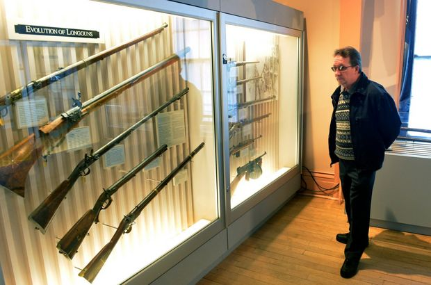 Visiter from Agawam , Edward Adamchek walks among the long gun exhibits at the 2013 Open House for the Springfield Armory Alliance.