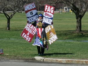 A member of the Westboro Baptist Church pickets at UMass.