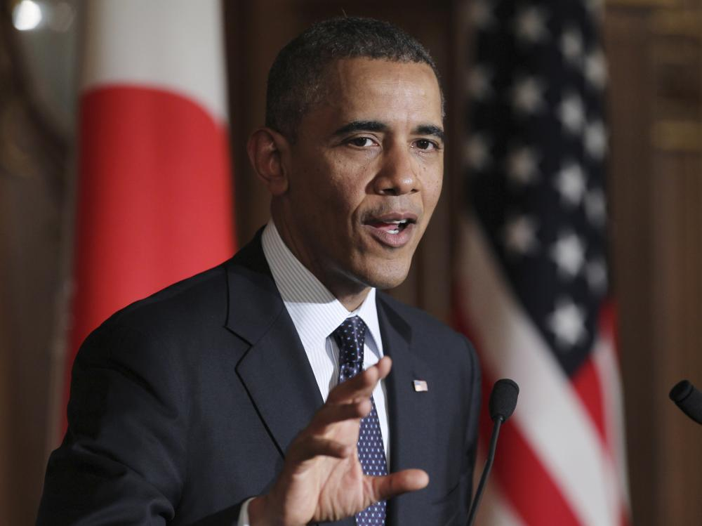 President Obama speaks as he attends a joint news  conference with Japan's Prime Minister Shinzo Abe at the Akasaka State Guest House in Tokyo, on Thursday. Obama reinforced the U.S.-Japan security commitment.