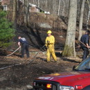 Firefighters battle a brush fire in Wilbraham, Mass., on April 21, 2014.