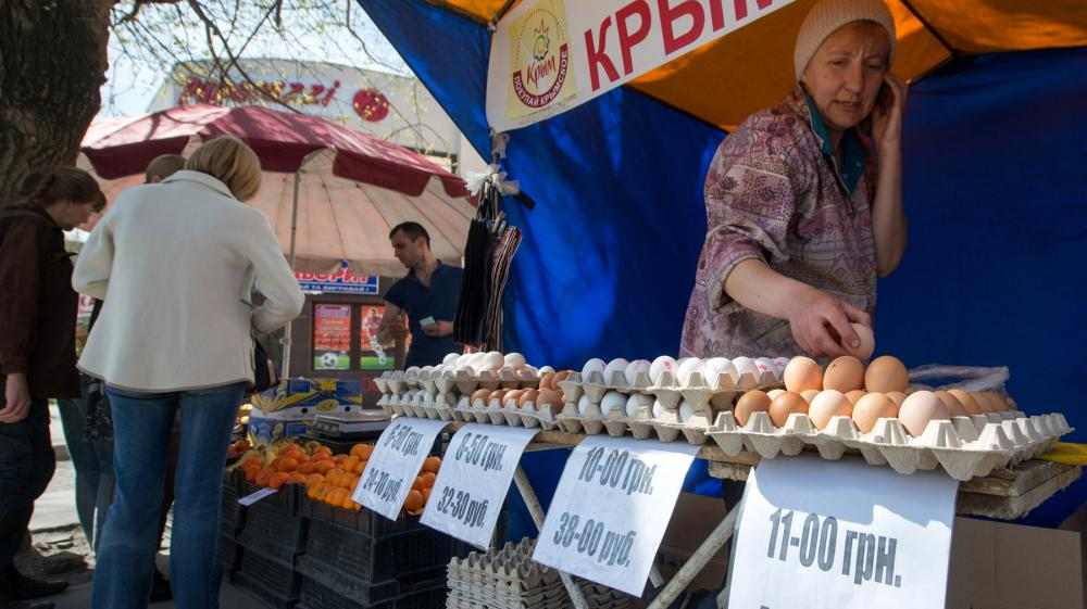 A street vendor in Crimea's capital Simferopol sells eggs with the dual currency price tags in Russian rubles and Ukrainian hryvnias. Russia's annexation of Crimea mean it will now have to prop up the peninsula's weak economy.