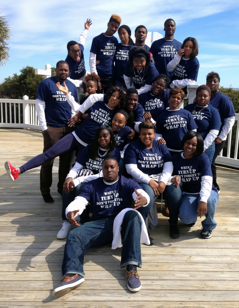 Michelle Nimmons (with the red shoe) poses with some of the students in her sex education program in Denmark, S.C.