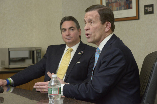 Steve Grossman and Springfield Mayor Domenic Sarno speaking about Grossman's gubernatorial campaign in January.