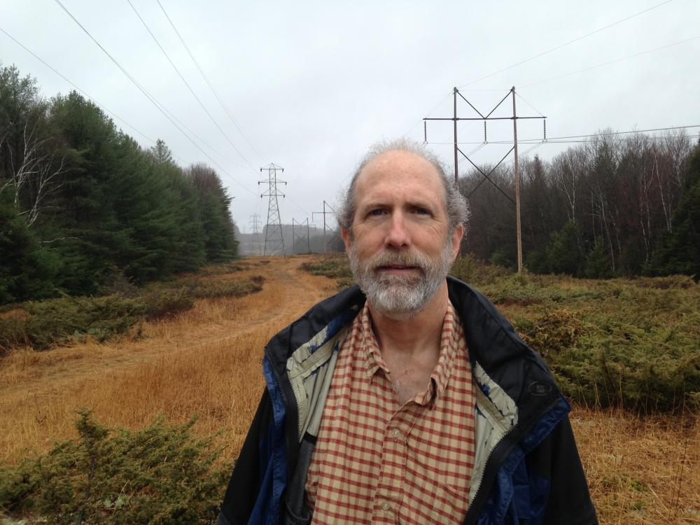 Jim Cutler stands where the proposed pipeline would pass through his land in Ashfield, Mass.