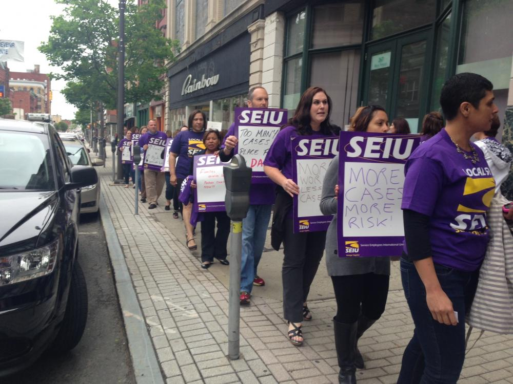 Workers at the Department of Children and Families picket in front of the agency's office in Holyoke, Mass. May 28, 2014
