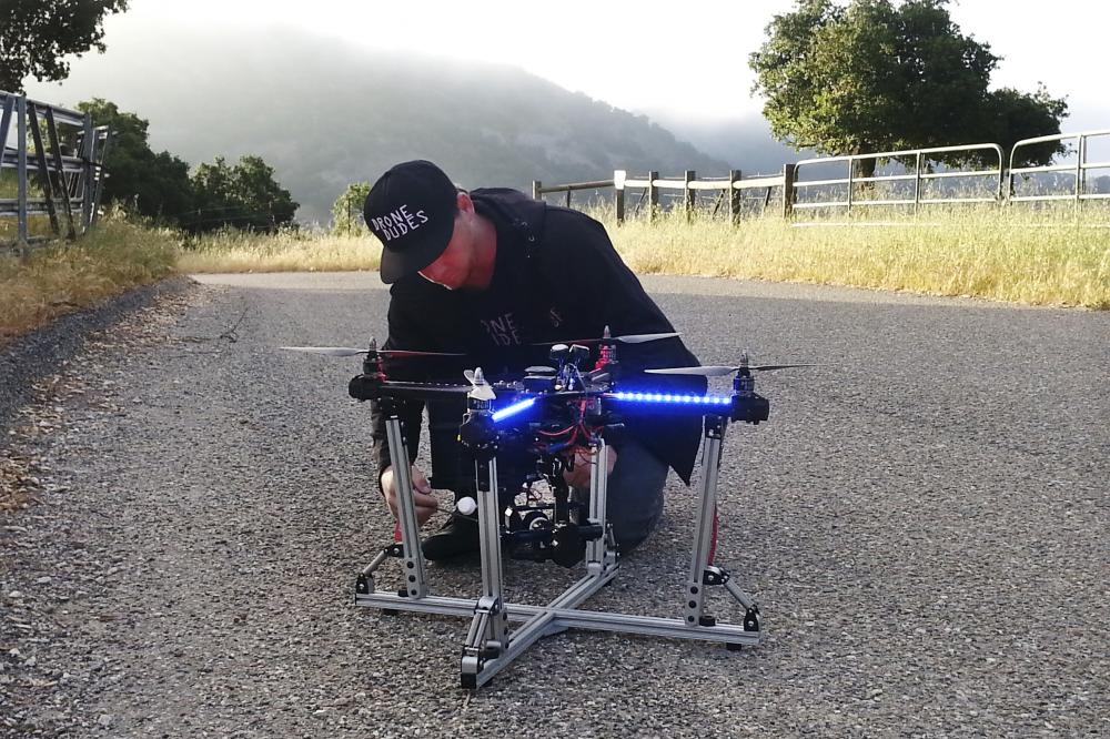 Jeff Blank, of Los Angeles-based Drone Dudes, prepares a quadcoptor for takeoff. The drone has to chase a motorcycle down a hill.