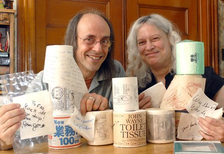 Rich and Flo Newman pose with some of the items from their toilet paper collection.