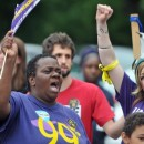 Supporters of a higher minimum wage and earned sick time rally in Springfield in June 2014.