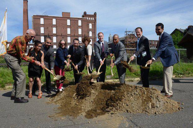 Gov. Deval Patrick, retired U.S. Rep. John Olver, Holyoke Mayor Alex Morse and other officials break ground on Phase 2 of the Canal Walk Project on Race Street  in Holyoke Mass. June 16, 2014