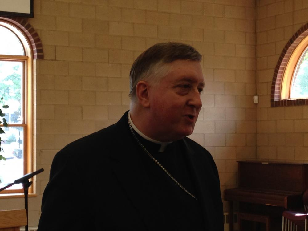 Incoming Bishop Mitchell Rozanski before a press conference in Springfield.