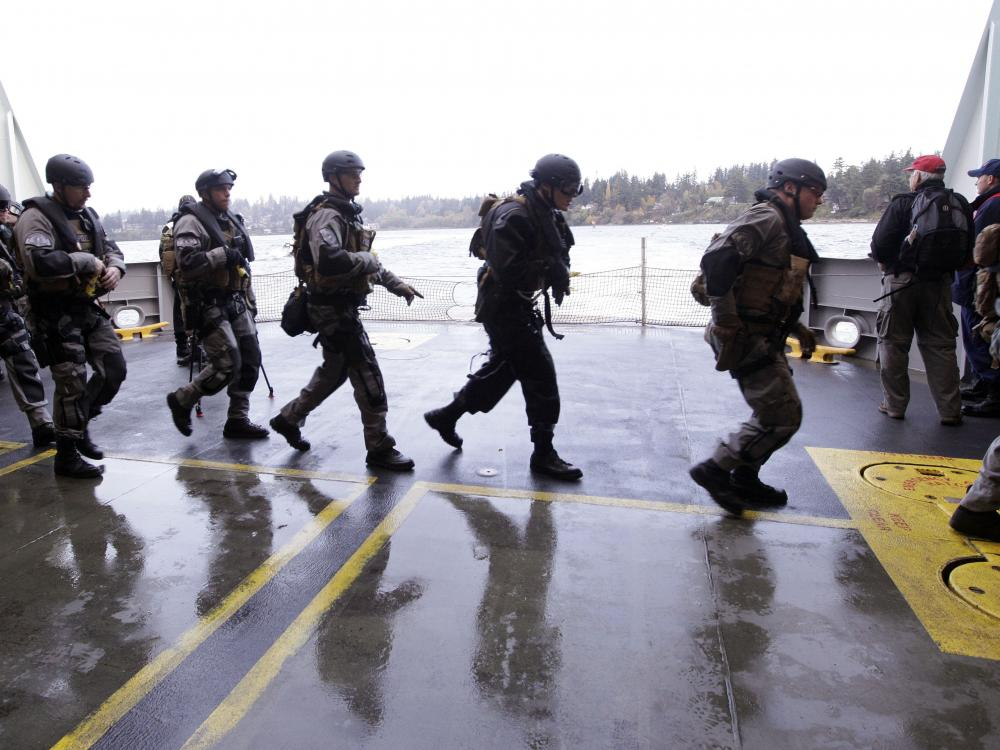 During a drill, SWAT team members prepare to secure a ship in Bainbridge Island, Wash.