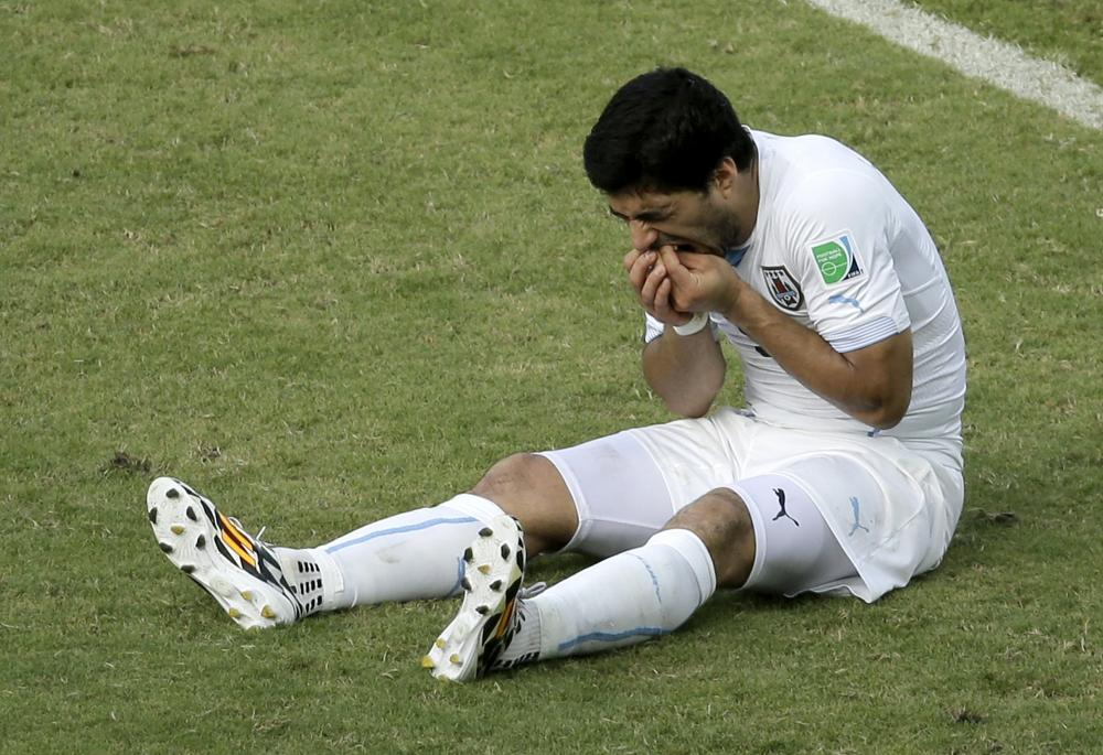 Uruguay's Luis Suarez reacts while sitting on the pitch during the group D World Cup soccer match between Italy and Uruguay in Brazil on Tuesday.