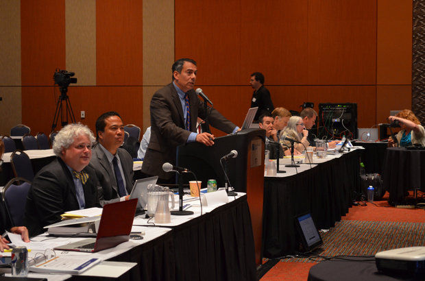 Commissioner Enrique Zuniga addresses fellow members of the Massachusetts Gaming Commission on MGM-Springfield's casino proposal at The MassMutual Center, Springfield on June 10, 2014. Seated next to him (left) is Michael Mathis, president of MGM-Springfield.