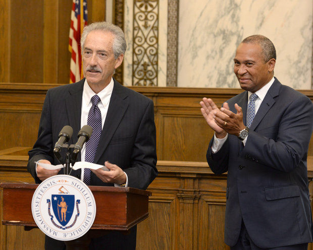 Gov. Deval Patrick applauds after introducing Jim Orenstein as interim Hampden County District Attorney, during a ceremony at the Governor's Office in Springfield, June 9, 2014