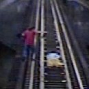 Video shows a woman trying to outrun a train.