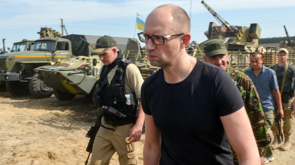 Ukrainian Prime Minister Arseniy Yatsenyuk visits forces stationed near the small city of Izyum on Wednesday