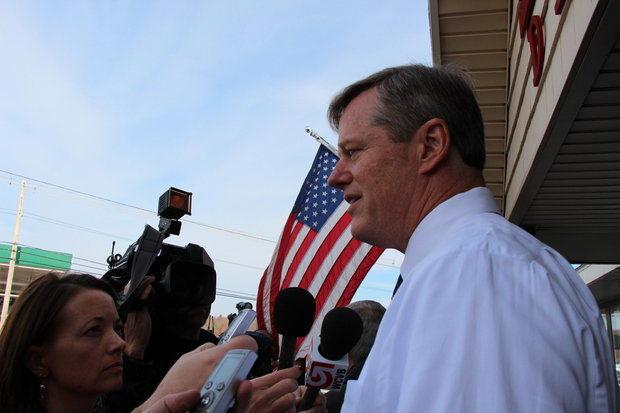 Gubernatorial candidate Charlie Baker speaks to reporters.