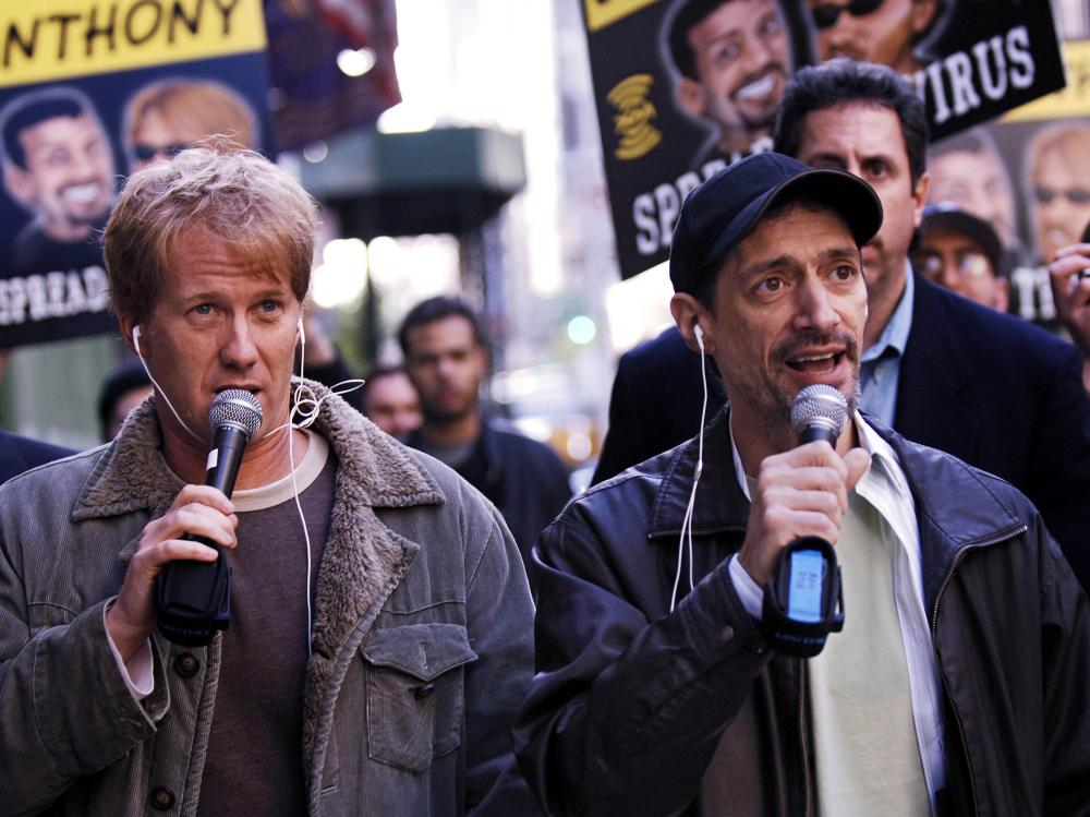 "Radio shock jocks Greg ""Opie"" Hughes (left) and Anthony Cumia walk to the XM Satellite Radio studios in 2006, in New York. The network fired Cumia on Thursday for what it said were ""racially-charged and hate-filled remarks."""