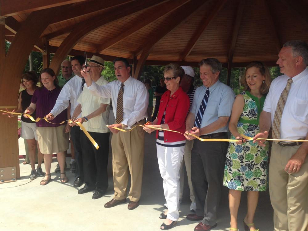 Springfield Mayor Domenic Sarno (scissors raised) joins local and state officials in ribbon-cutting ceremony to celebrate the re-opening of Camp Wilder,  July 1, 2014.