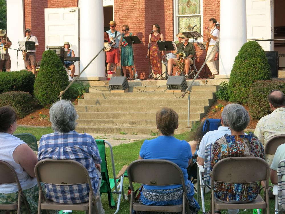 Members of the Broken Cello Orchestra play on the steps of Montague Village's Congregational Church