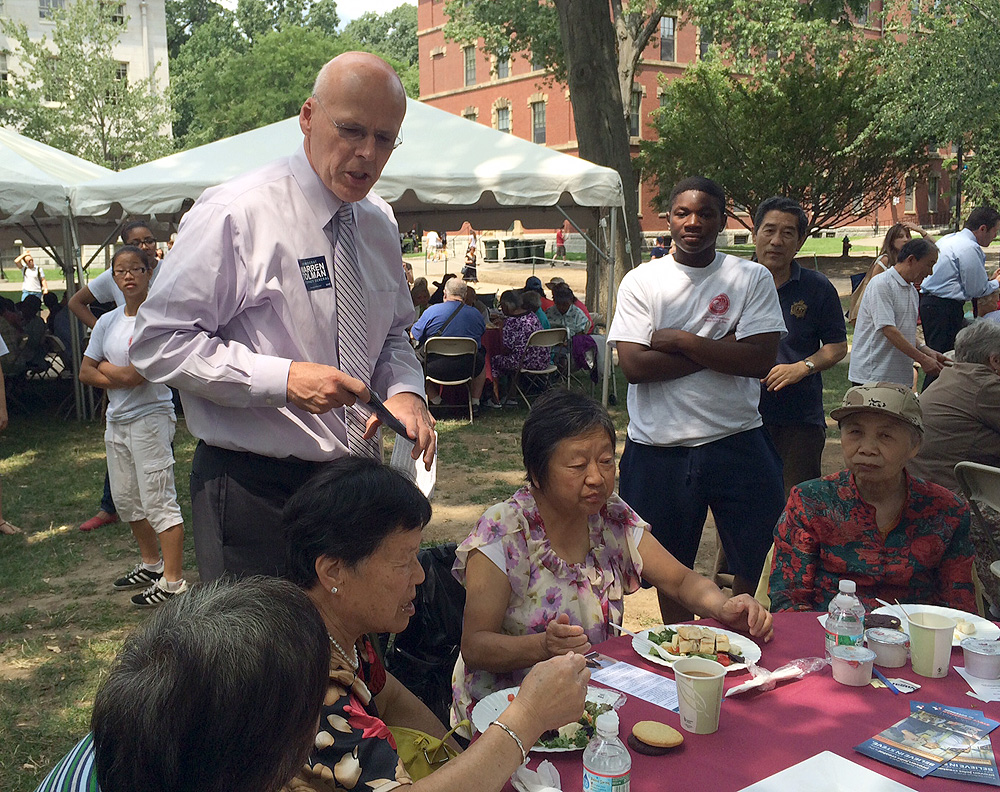 Warren Tolman worked the crowd at a recent senior lunch in Cambridge.