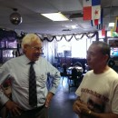 Massachusetts Democratic candidate for governor Don Berwick (left) chats with restaurant owner Jose Bou during a campaign stop in Holyoke on Friday, August 1st.