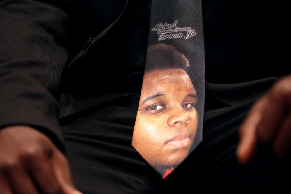 Some attendees at Michael Brown's funeral Monday in St. Louis wore ties and buttons depicting the 18-year-old, who was killed two weeks ago in Ferguson, Mo.