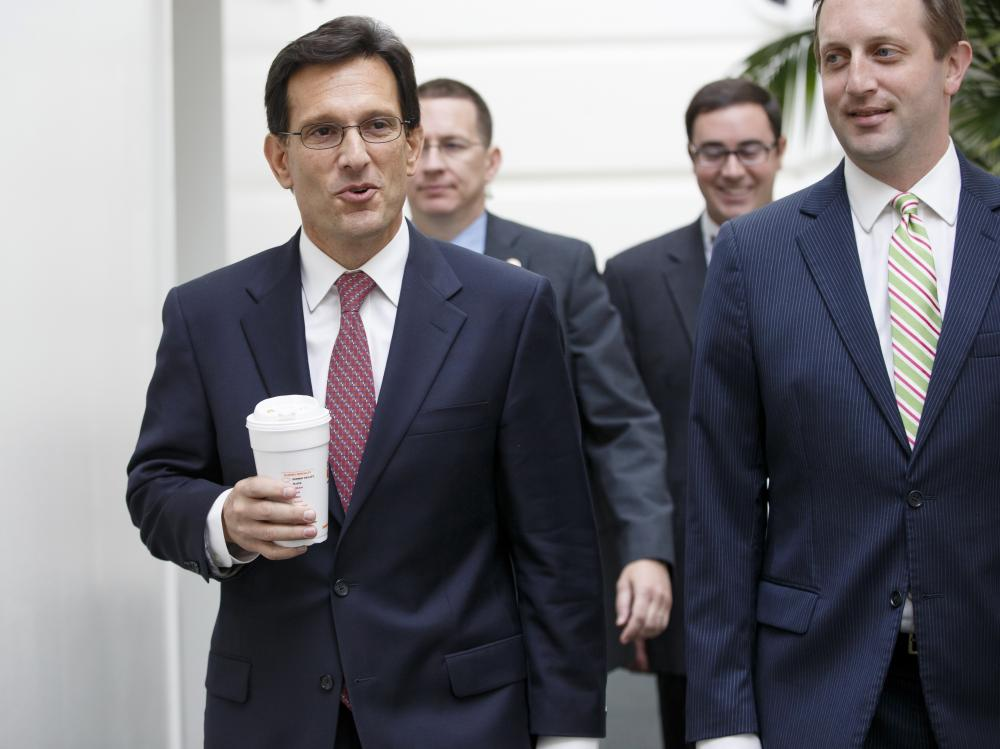 House Majority Leader Eric Cantor of Va., left, on Capitol Hill in Washington on Tuesday. Cantor relinquished his leadership post on Thursday and said he would step down before the end of his term.
