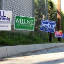 Signs for Vermont candidates line the parking lot outside a polling place in Burlington on Tuesday, Aug. 26, 2014.