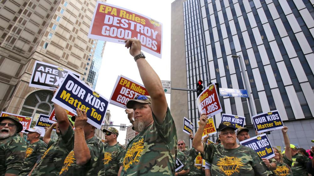 Some 5,000 union members, led by the United Mine Workers of America, march outside the William S. Moorhead Federal Building on Thursday, during the first of two days of public hearings being held by the Environmental Protection Agency in Pittsburgh to discuss stricter pollution rules for coal-burning power plants proposed by the EPA.