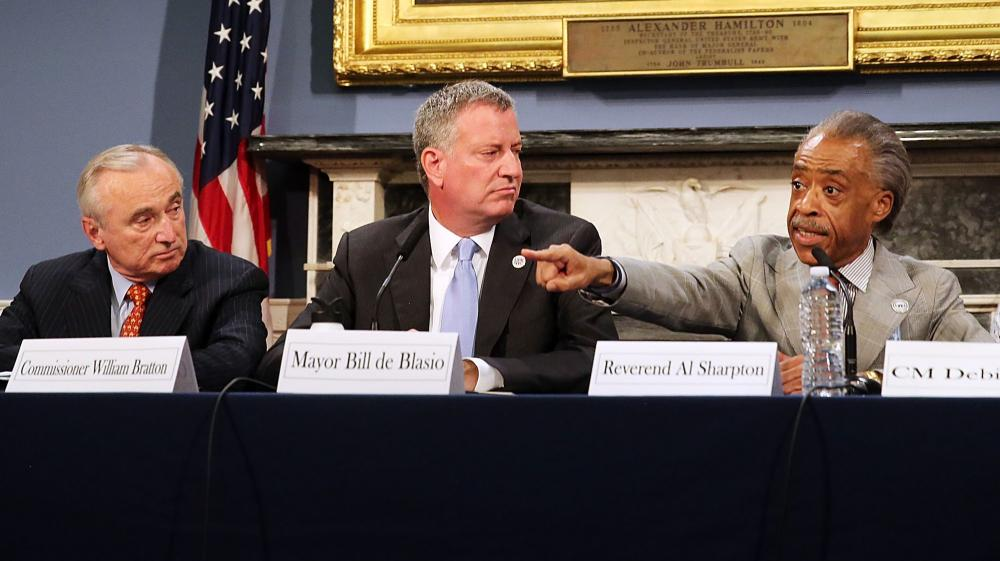 The death of Eric Garner in police custody has sparked controversy in New York City — and it's now been ruled a homicide. On Thursday, New York Mayor Bill de Blasio (center) sat with Police Commissioner Bill Bratton (left) and the Rev. Al Sharpton during a discussion on police-community relations.