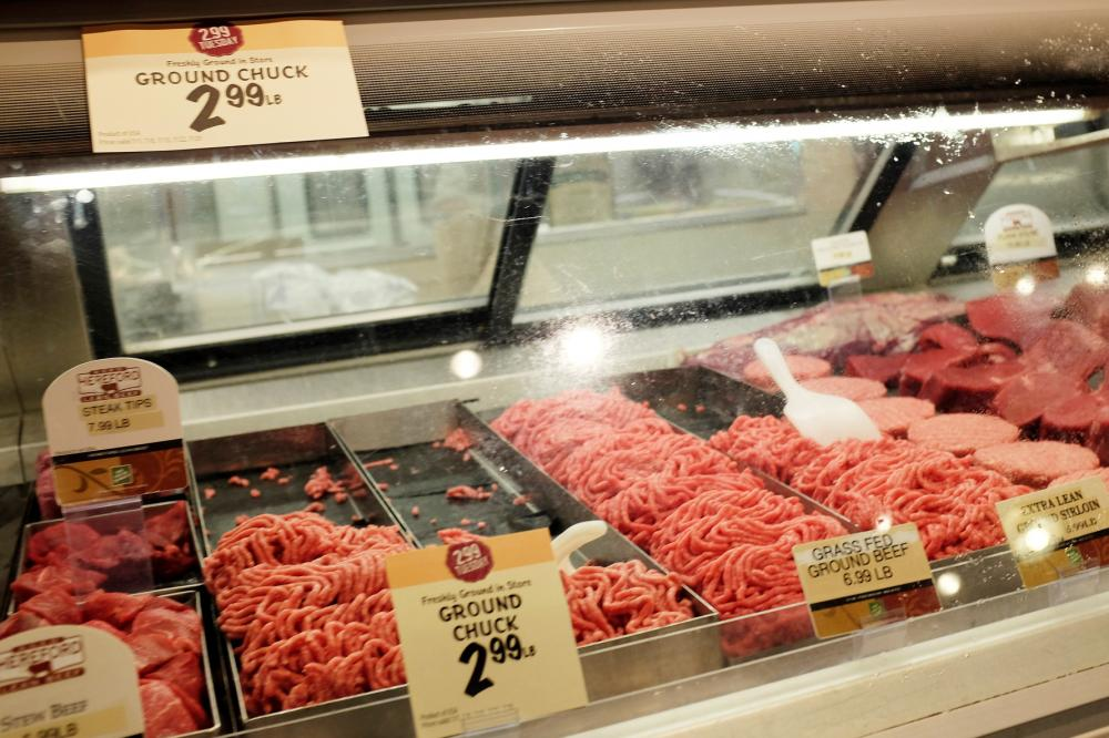 Meat is displayed in a case at a grocery store on July 8 in Miami, Fla. Pork and beef prices are up more than 11 percent since last summer.