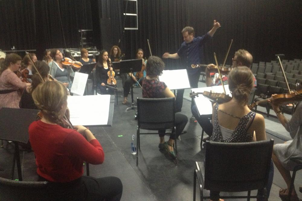 Conductor Brian Lubman leads Bang On A Can fellows through a rehearsal